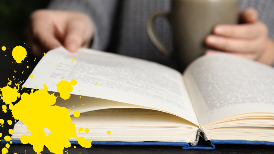 Someone reading a book with yellow splat