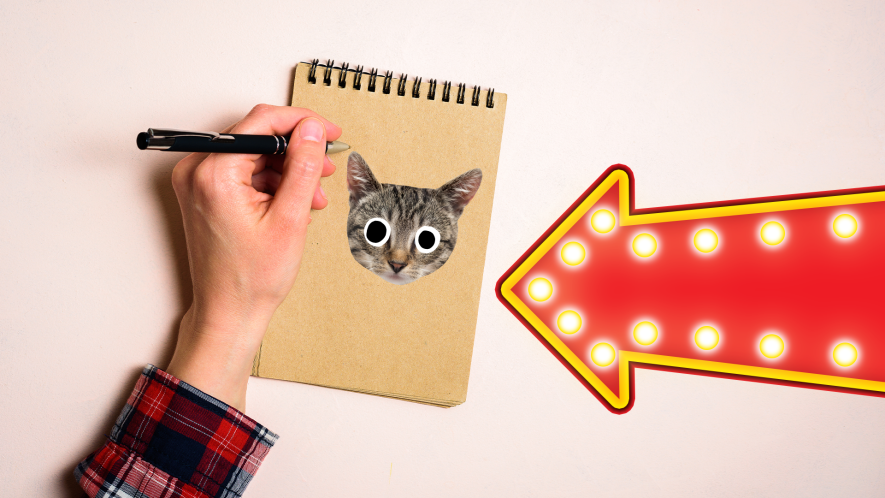 Lef hander writing on notepad with cat face and light up arrow