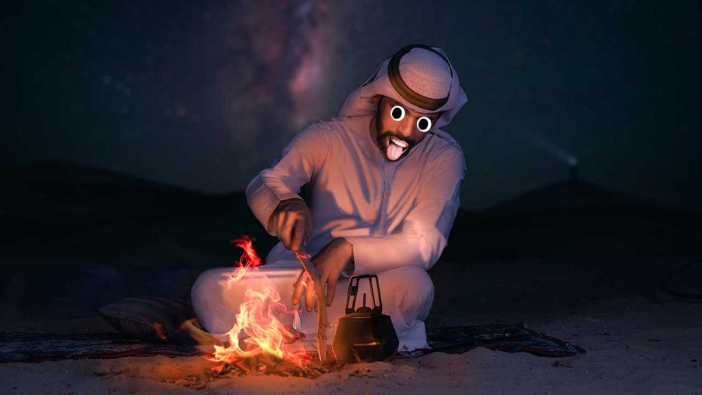 A man preparing a fire in the desert