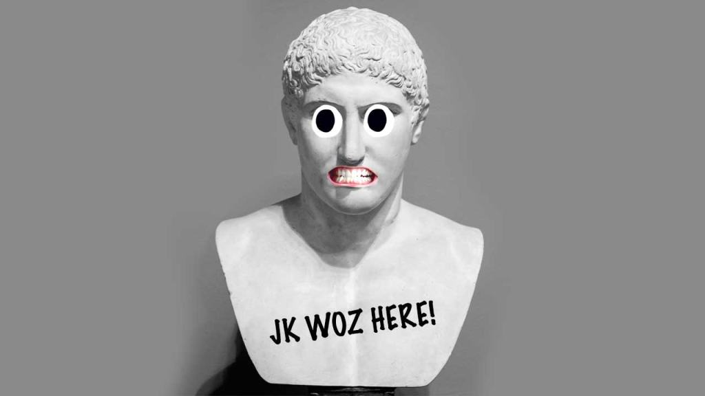 Marble statue head with writing on it