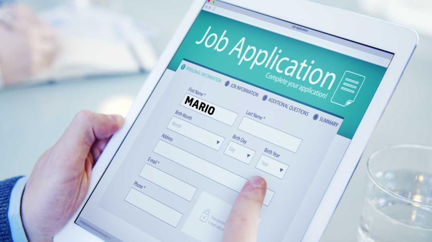 Mario filling out a job application