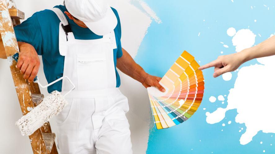 A painter holding a paint colour chart