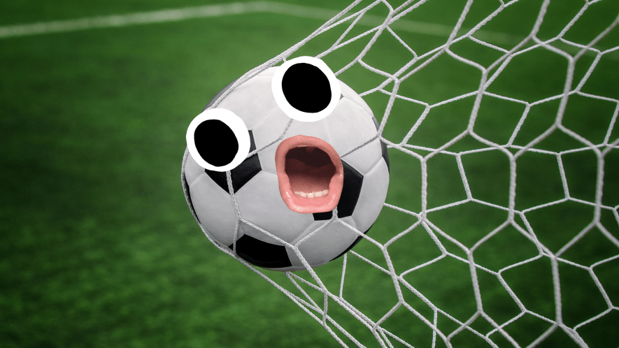 Football with face in goal net