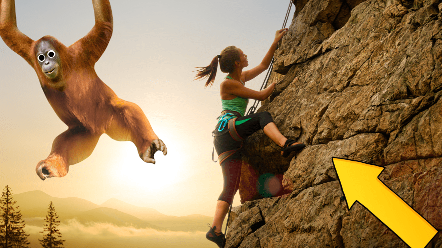 Woman rock climbing, arrow and Beano orangutan