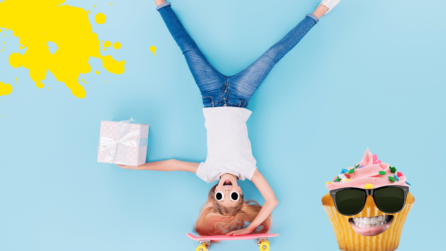 Girl upsidedown on skateboard with present and cool fairy cake