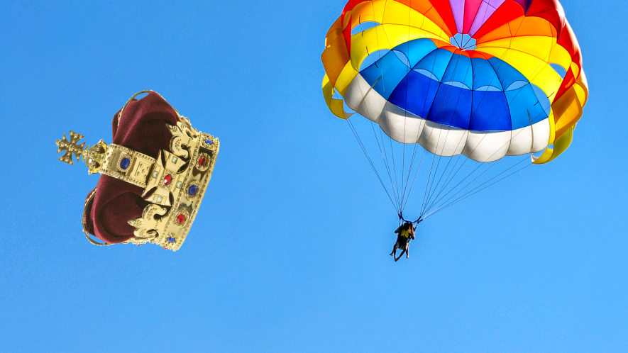 Person with parachute in sky and crown