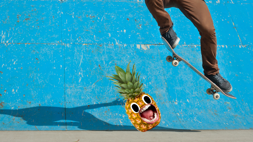 Pinapple screams as skateboarder jumps over it on blue ramp
