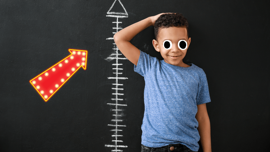 Boy against height chart with arrow