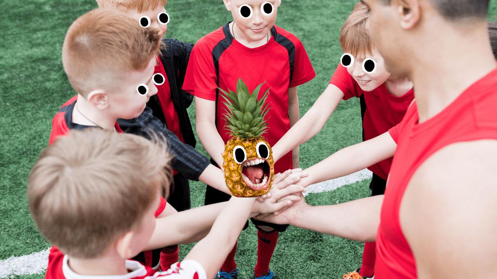 Boys football team in a huddle