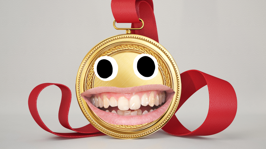 Gold medal with goofy face