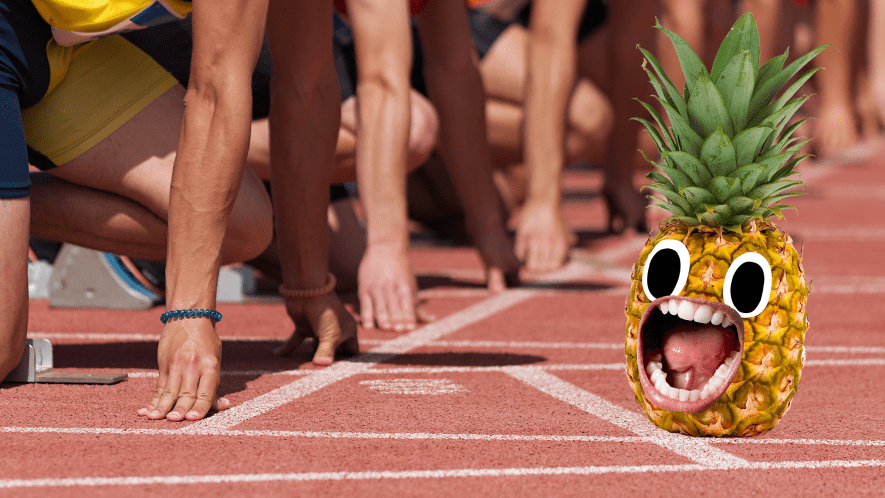 Runners at start line and screaming pineapple