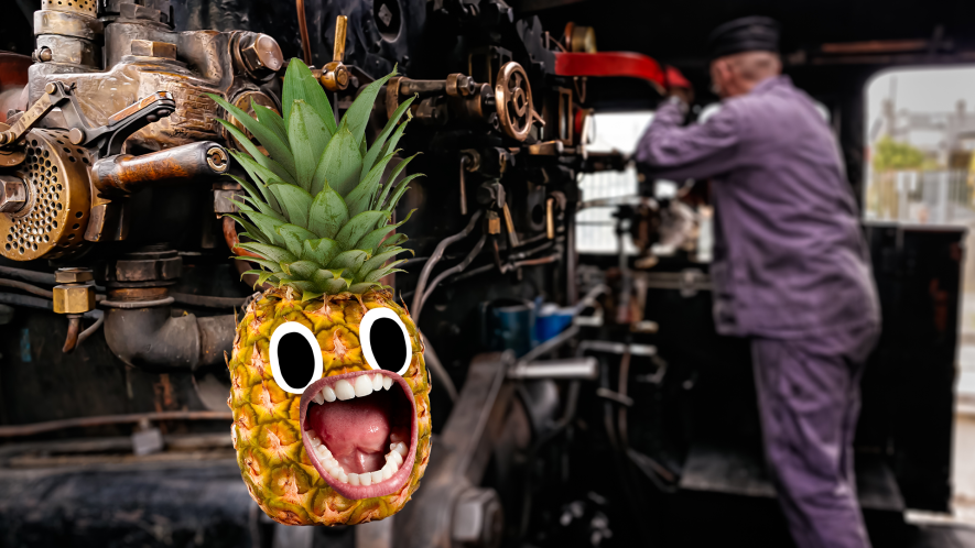 Steam train engine with man and screaming pineapple