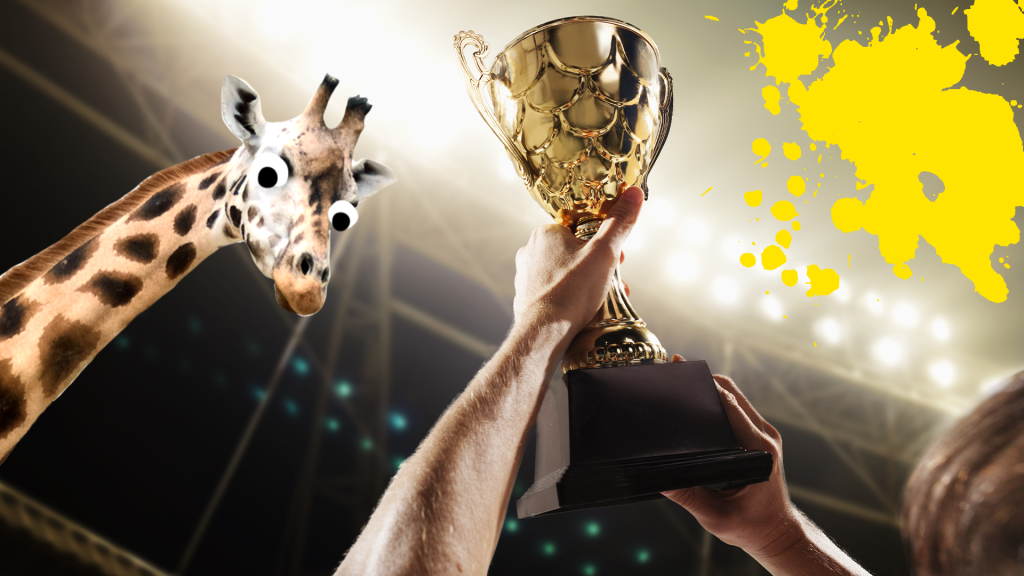 Hand holding trophy in stadium with yellow splats and goofy giraffe