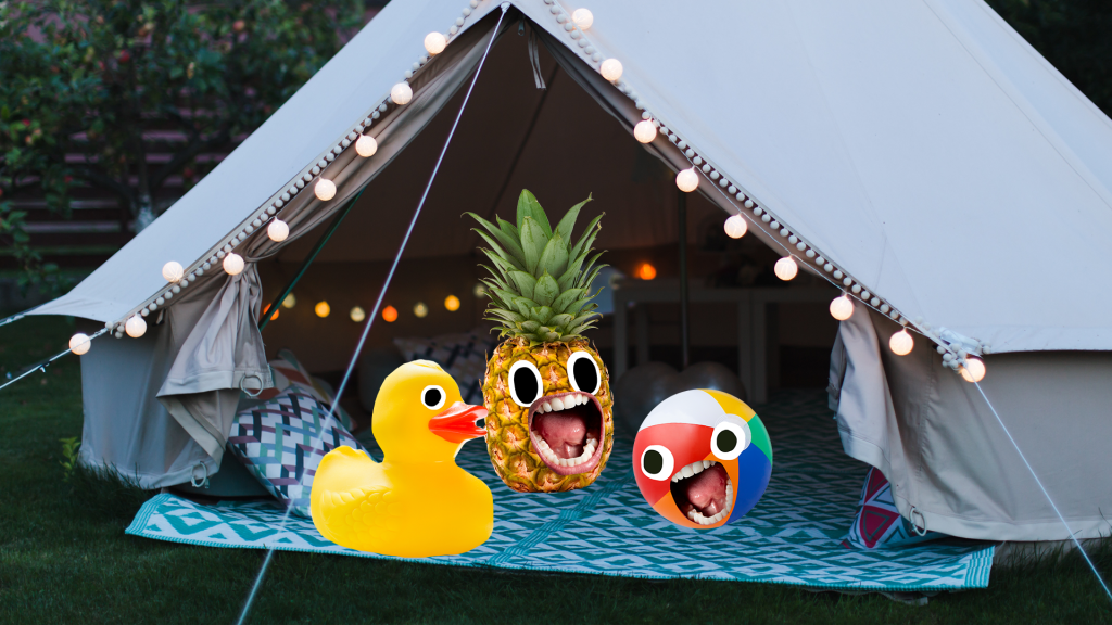 Duck, pineapple and ball with faces in tent