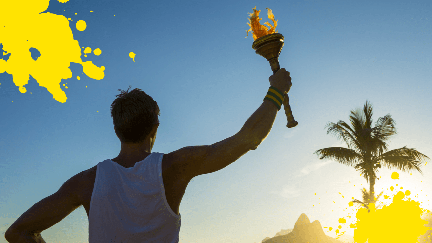 Man holding Olympic torch in twilight with yellow splats