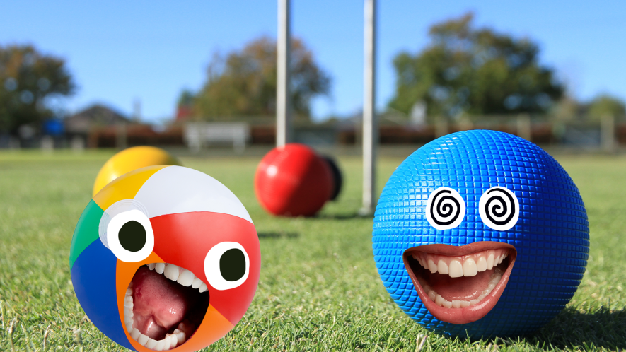 Croquet equipment on lawn, ball with face and beach ball with face