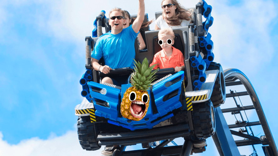 Family on rollercoaster with screaming pineapple