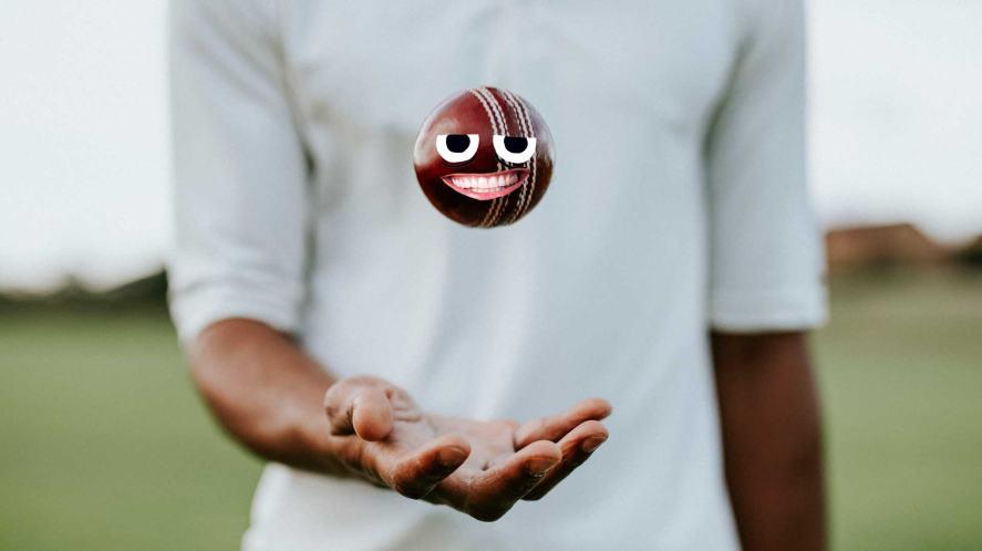 A cricket bowler throwing a ball into the air