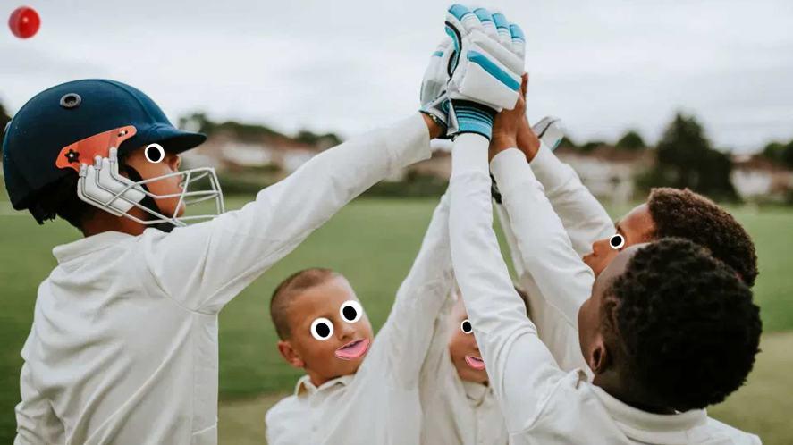 A cricket team high-fiving