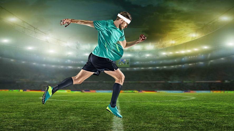A footballer hiding the ball in his shirt