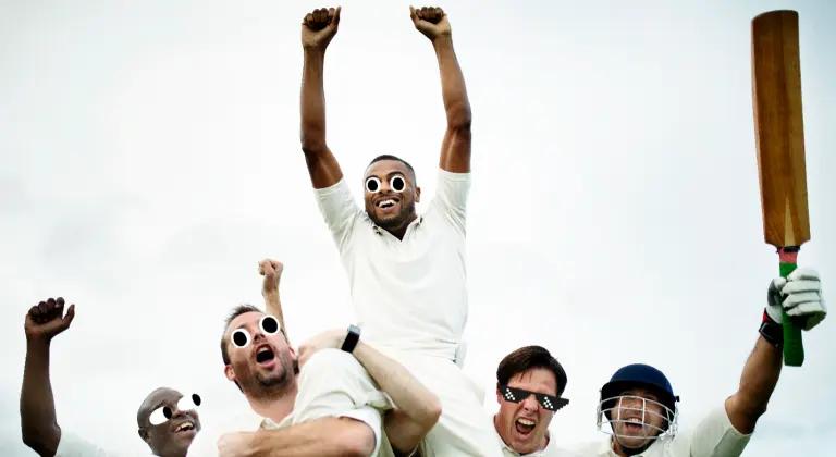 A cricket team celebrating