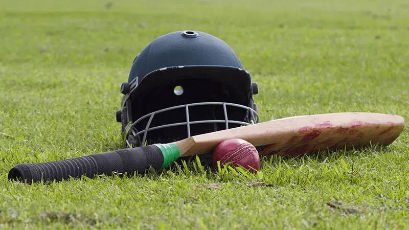 A cricket helmet and bat