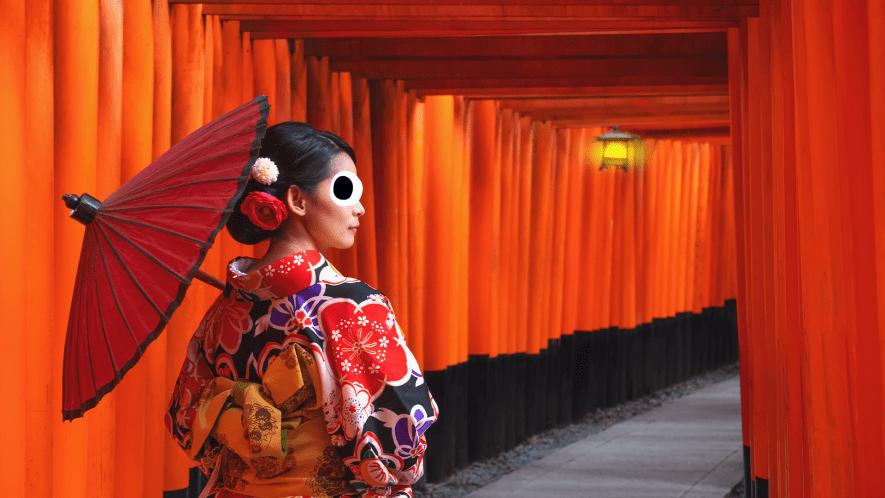 Japanese woman in silk Komono with umbrella