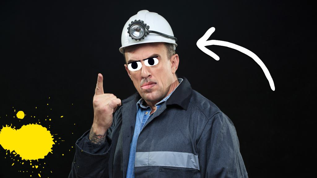 A miner wearing a head torch