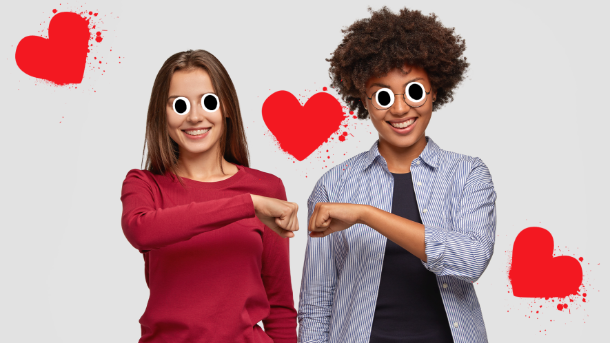 Two female friends bumping fists on white background with splat hearts