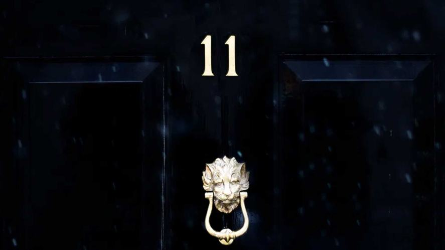 A door with 11 and a knocker