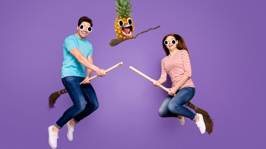 Man and woman on brooms on purple background, with Beano pineapple on broom