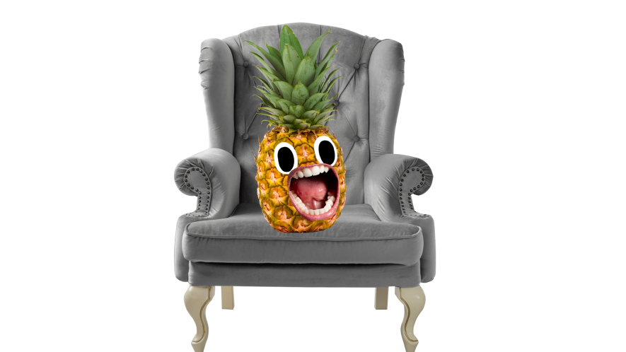 Pinapple sitting in silver chair on white background