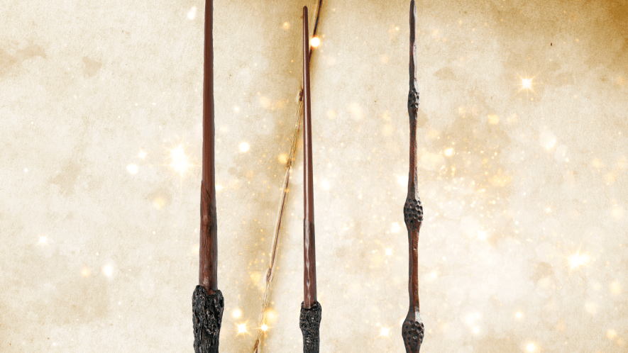 Three Beano wands on paper book background