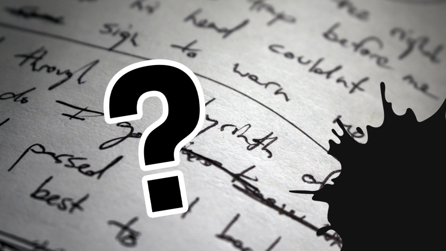 Page with writing, black splats and question mark