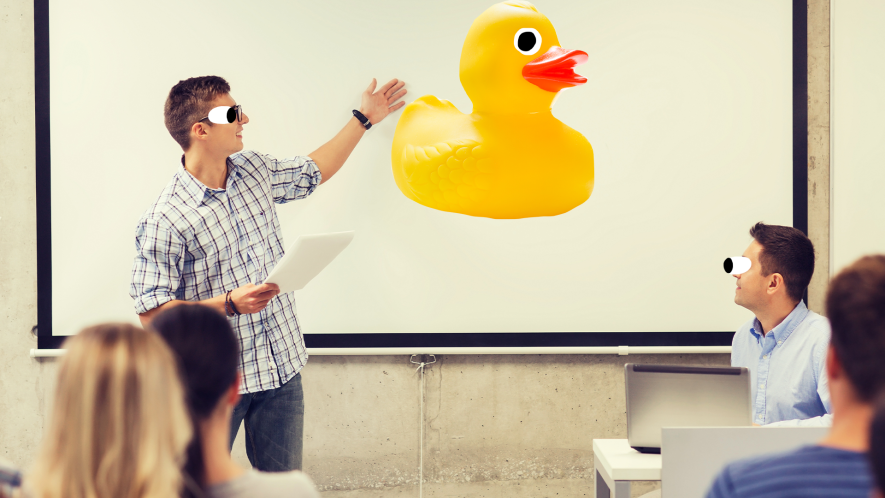 Guy giving presentation with goofy Beano rubber duck