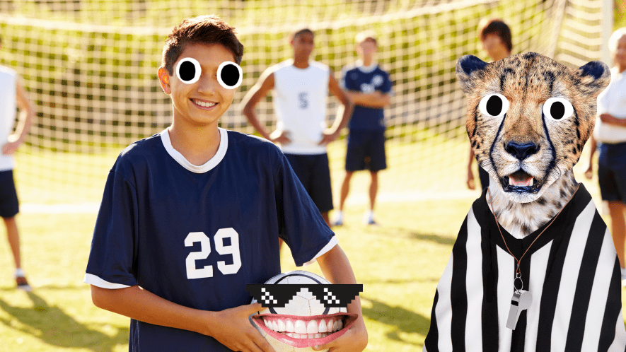 Smiling boy on football field with goofy football and referee cheetah