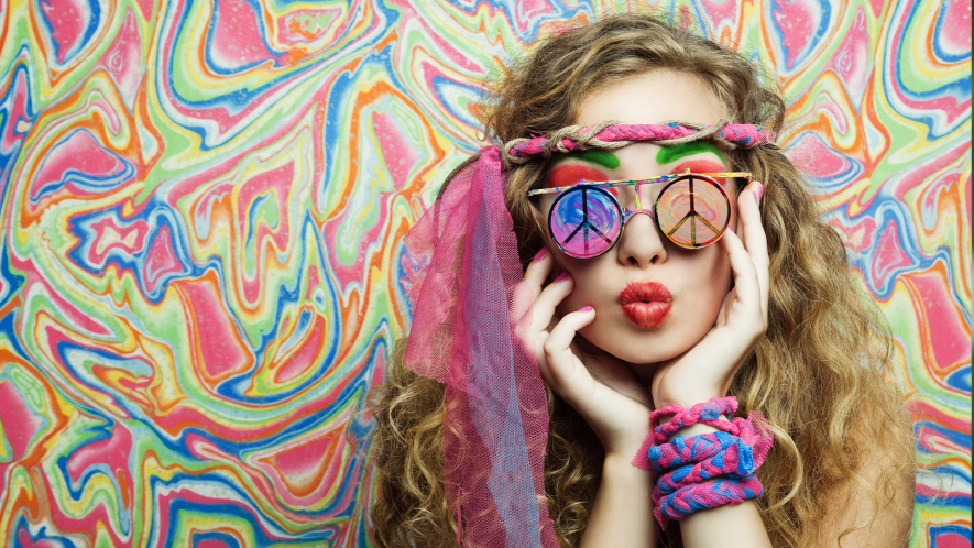 Hippy girl with peace symbol sunglasses