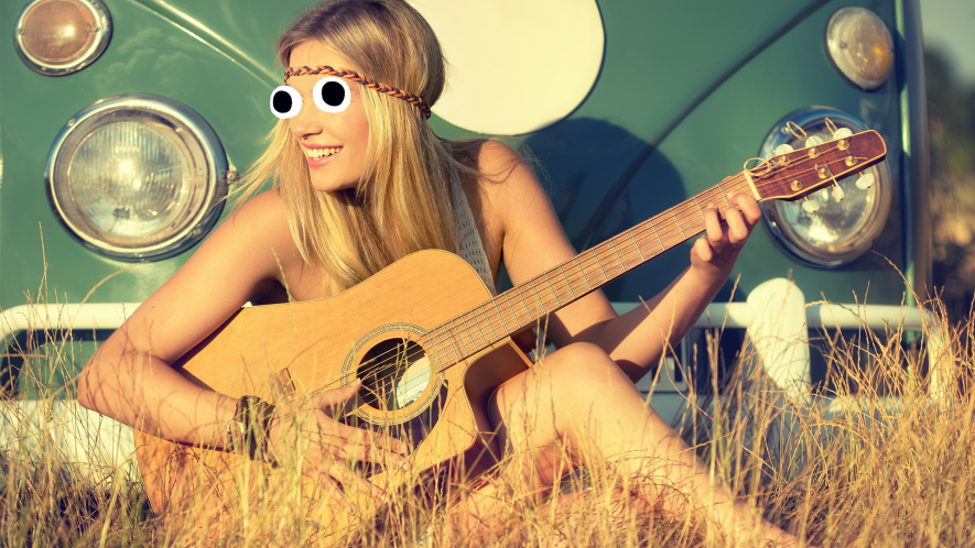 Girl playing guitar in a field