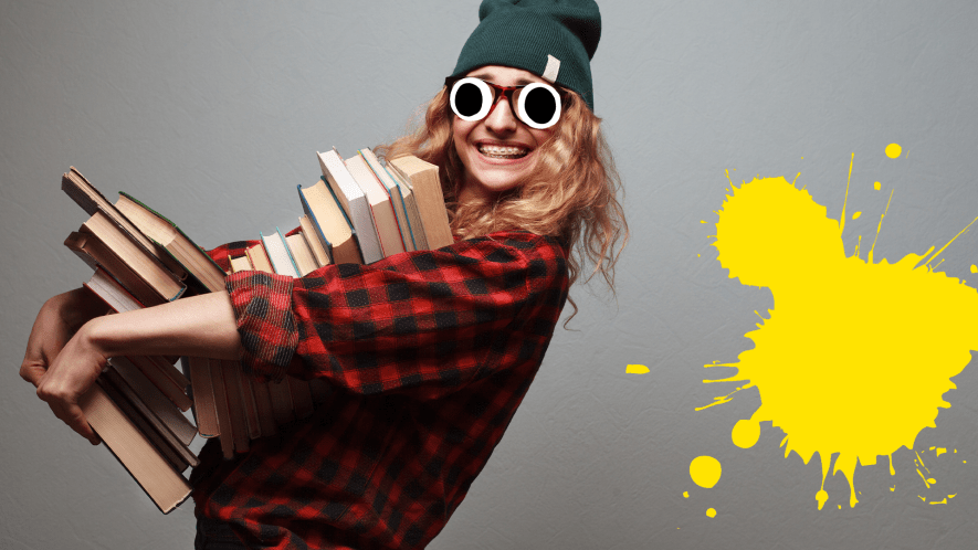 Girl with pile of books on grey background with splat
