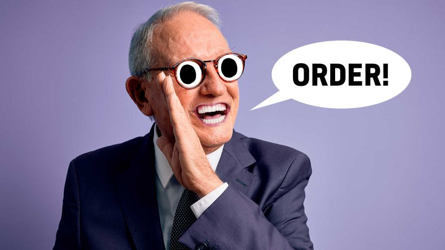 A suited man saying 'order'