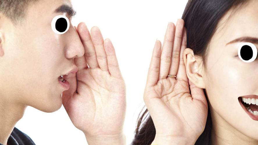 Someone speaking into another person's ear