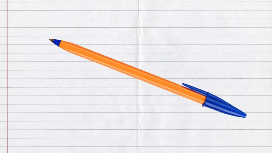 A ballpoint pen rests on a sheet of lined paper