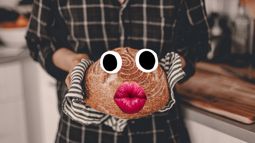 A person holds a cake from the oven