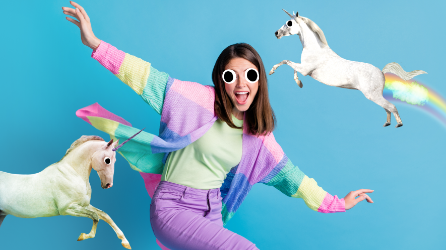 A brightly dressed woman hanging out with unicorns