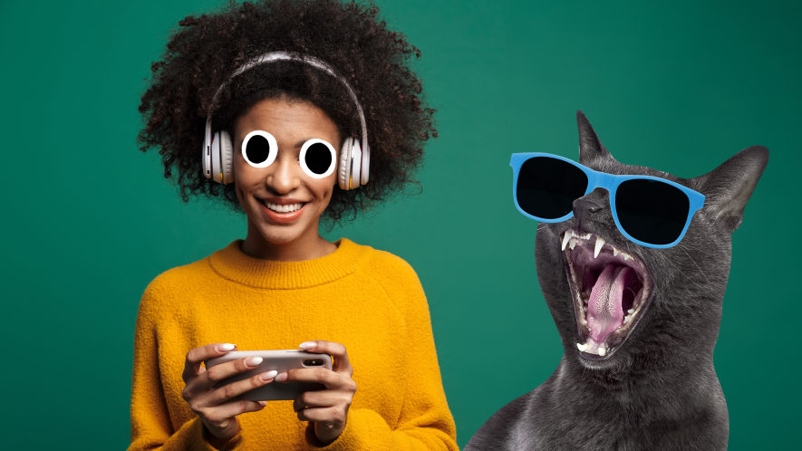 A woman listens to music on big headphones while a cat sings along