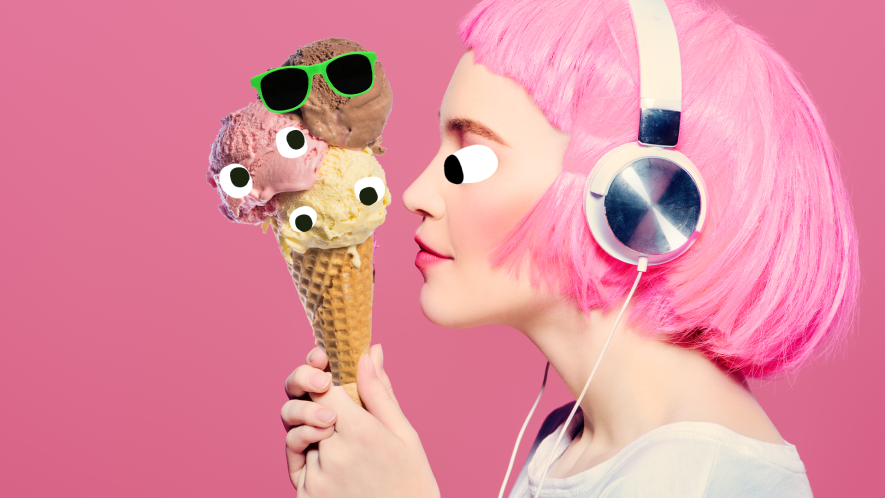 A woman with pink hair looks at a triple scoop of ice cream
