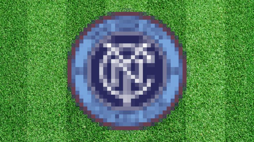 A blurred football badge