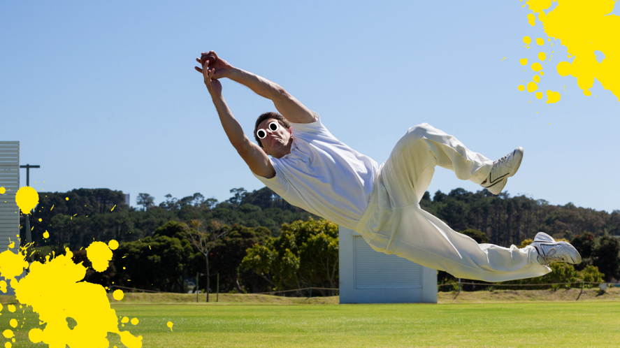 A cricket player making a catch
