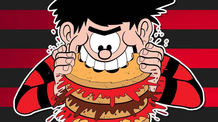 Dennis biting into a massive burger