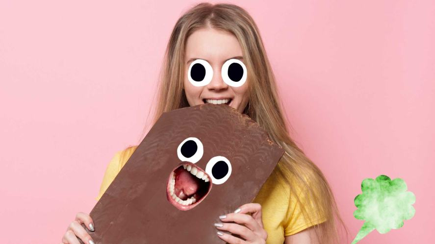 A woman eating a massive bar of chocolate